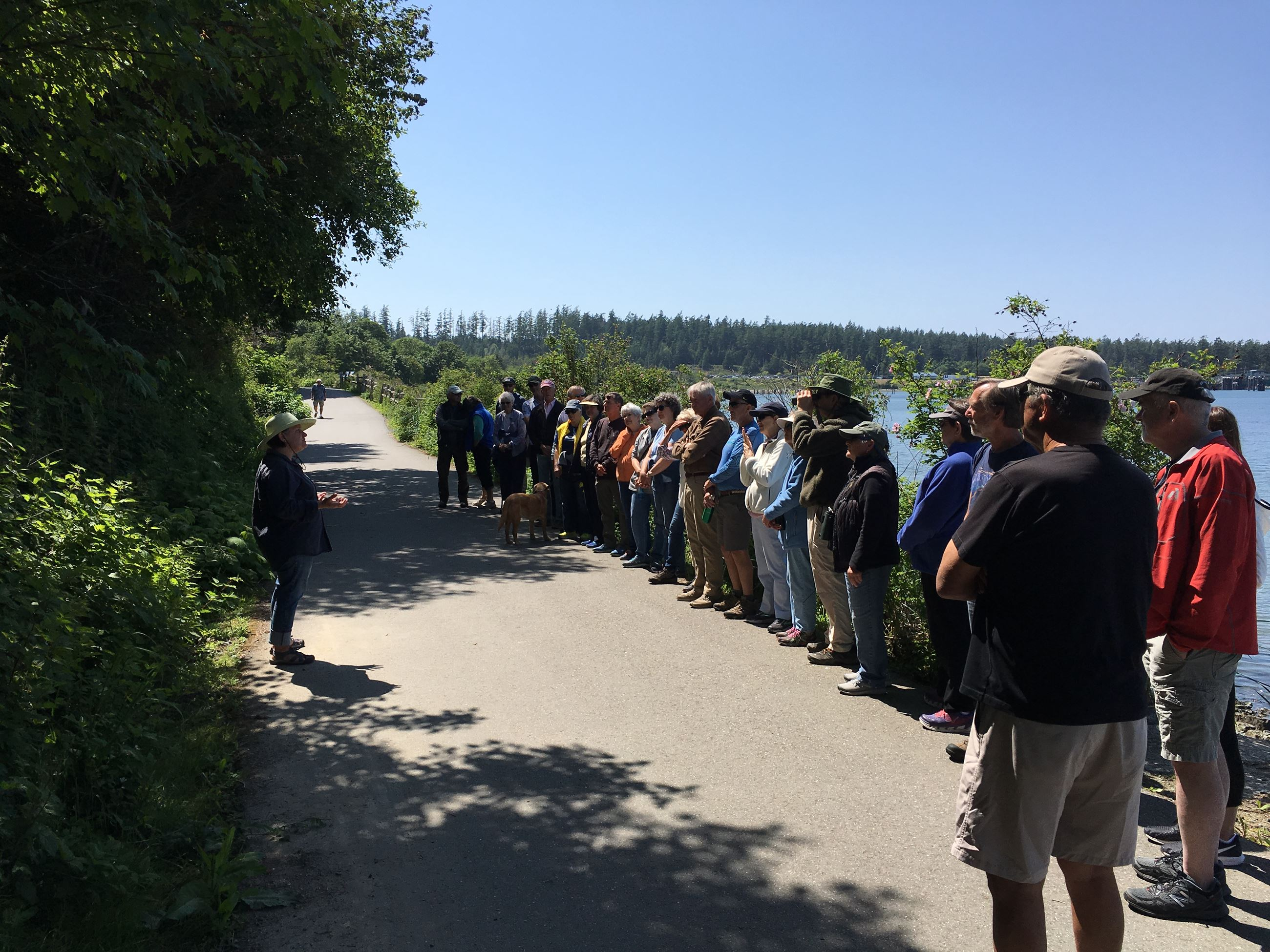 Fidalgo Island Naturalist Denise Crowe speaks to a GCT community hike group in early June