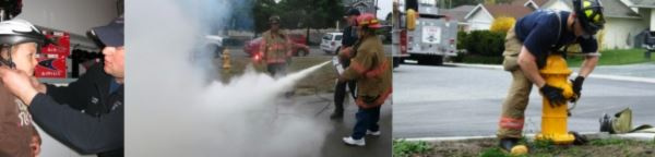Firefighters using fire equipment